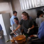 teens working as a team at the kitchen