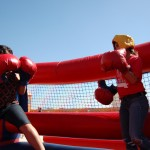 girls stundents playing inflatable boxing