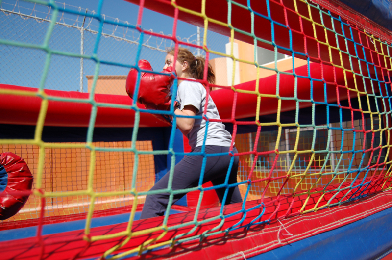 girls stundents playing box at the inflatable ring