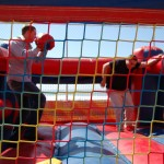 stundent and staff playing boxing ring